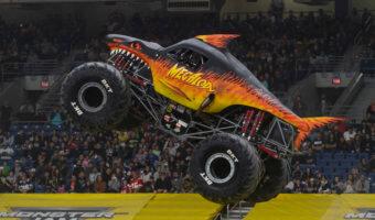 Megalodon Fire Monster Jam Truck in Air
