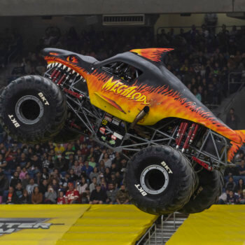 Megalodon Fire Monster Jam Truck in Air