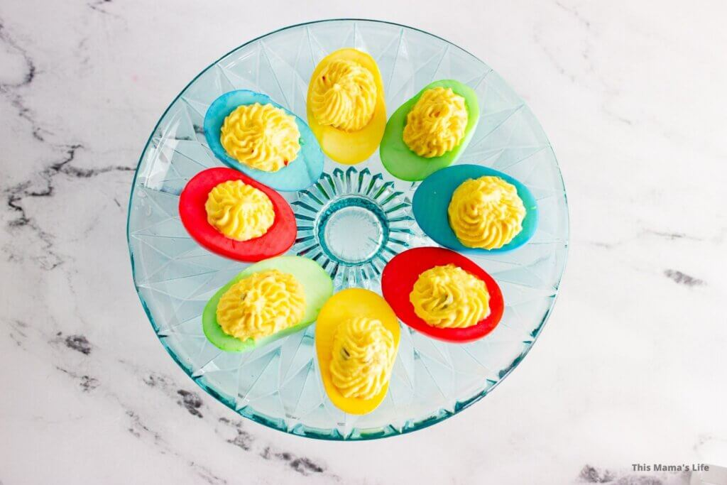 Brightly colored Easter eggs on a blue cake stand