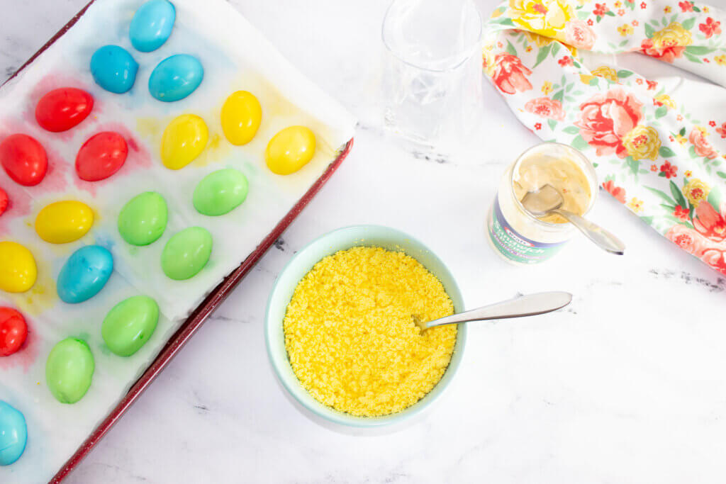 Mashing egg yolks with a fork in a blue bowl